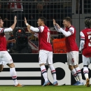 Arsenal s Aaron Ramsey, 2nd right, celebrates with teammates Oliver Giroud, left, Mesut Ozil and Bacary Sagna after scoring during the Champions League group F soccer match between Borussia Dortmund and Arsenal FC in Dortmund, Germany, Wednesday,Nov.6,201