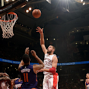 TORONTO, CANADA - November 24: Jonas Valanciunas #17 of the Toronto Raptors shoots against the Phoenix Suns on November 24, 2014 at the Air Canada Centre in Toronto, Ontario, Canada. (Photo by Ron Turenne/NBAE via Getty Images)