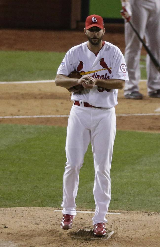 St. Louis Cardinals starting pitcher Adam Wainwright reacts after giving up a ground rule double to Boston Red Sox's David Ross during the seventh inning of Game 5 of baseball's World Series Monday, Oct. 28, 2013, in St. Louis. Red Sox's Xander Bogaerts scored on the hit