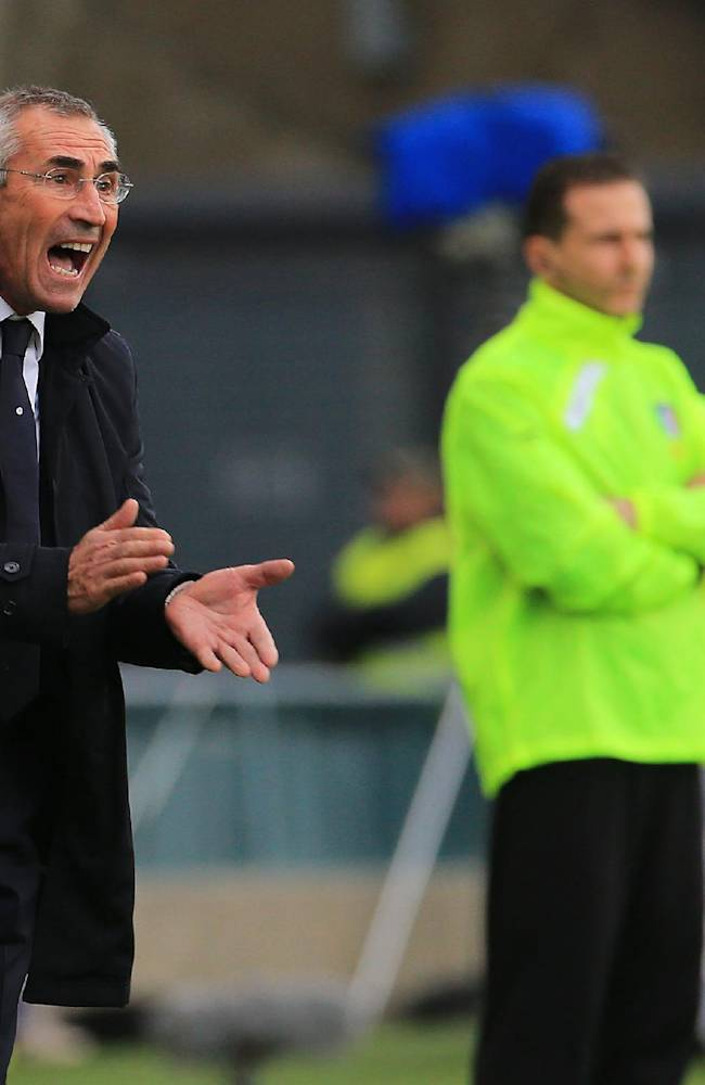 Lazio's coach Edy Reja shouts as he watches the Serie A soccer match between Udinese and Lazio at the Friuli Stadium in Udine, Italy, Sunday, Jan. 19, 2014