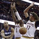 Charlotte Bobcats' Gerald Henderson, left, passes around Cleveland Cavaliers' C.J. Miles, second from left, and Anderson Varejao, from Brazil, during the first quarter of an NBA basketball game Friday, Nov. 15, 2013, in Cleveland The Associated Press