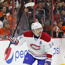 Montreal Canadiens' Tomas Plekanec, of the Czech Republic, reacts to his goal during the third period of an NHL hockey game against the Philadelphia Flyers, Saturday, Oct. 11, 2014, in Philadelphia. The Canadians won 4-3 in a shootout The Associated Press