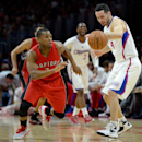 LOS ANGELES, CA - DECEMBER 27: Kyle Lowry #7 of the Toronto Raptors steals the ball from J.J. Redick #4 of the Los Angeles Clippers during the first half at Staples Center on December 27, 2014 in Los Angeles, California. (Photo by Harry How/Getty Images)