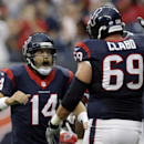 Houston Texans' Ryan Fitzpatrick (14) celebrates with Tyson Clabo (69) after teammate Alfred Blue scored a touchdown against the Atlanta Falcons during the first quarter of an NFL preseason football game Saturday, Aug. 16, 2014, in Houston The Associated