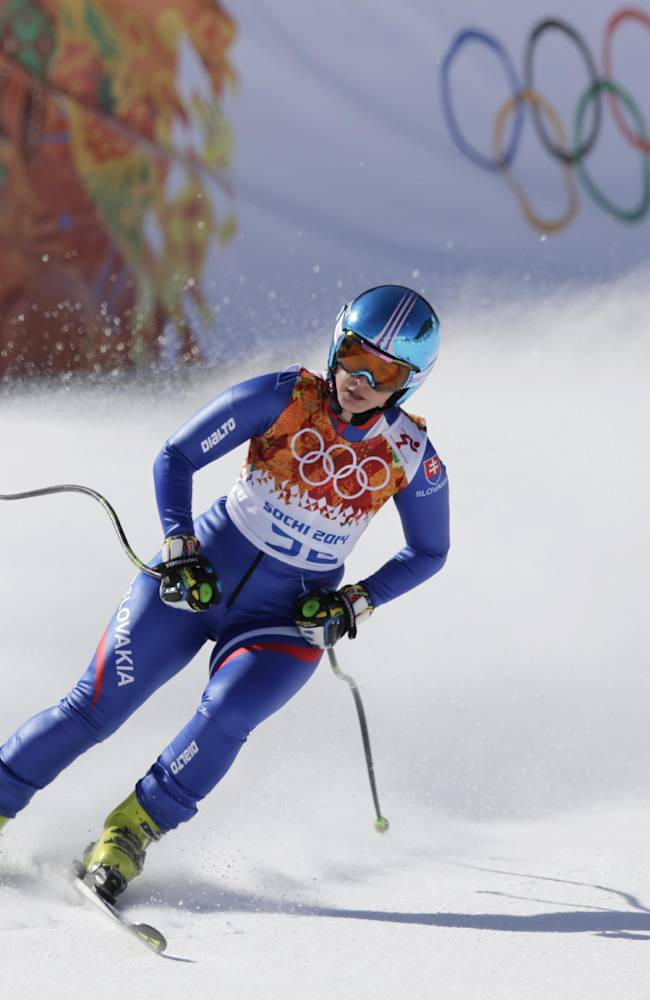 Slovakia's Kristina Saalova comes to a halt at the end of a women's downhill training run for the Sochi 2014 Winter Olympics, Friday, Feb. 7, 2014, in Krasnaya Polyana, Russia