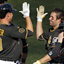 Pittsburgh Pirates' Neil Walker, right, celebrates with teammate Jordy Mercer (10) after hitting a walk-off solo-home run off Chicago Cubs relief pitcher Carlos Villanueva during the tenth inning of a baseball game in Pittsburgh, Monday, March 31, 2014. T