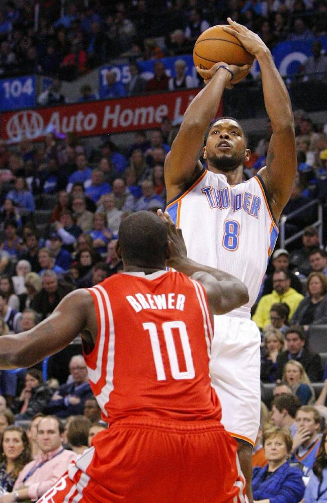 In this Dec. 29, 2013, file photo, Oklahoma City Thunder forward Ryan Gomes, rear, shoots over Houston Rockets forward Ronnie Brewer during the third quarter of an NBA basketball game, in Oklahoma City. The Memphis Grizzlies have acquired guard Courtney Lee and have sent guard Jerryd Bayless to the Boston Celtics as part of a three-team trade that also includes the Thunder. Under terms of the deal announced Tuesday, Jan. 7, 2014, the Grizzlies get Lee and a 2016 second-round draft pick from Boston. The Celtics get Bayless and also receive forward Ryan Gomes from Oklahoma City. The Thunder receive a conditional 2017 second-round draft pick from Memphis