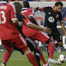 D.C. United forward Dwayne De Rosario, right, controls the ball against the Chicago Fire during the first half of the Lamar Hunt U.S. Open Cup semifinal soccer match on Wednesday, Aug. 7, 2013, in Bridgeview, Ill. (AP Photo/Nam Y. Huh)