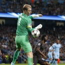 Manchester City's goalkeeper Joe Hart misses the ball during a Champions League group E soccer match between Manchester City and Roma at the Etihad Stadium, Manchester, England, Tuesday, Sept. 30, 2014