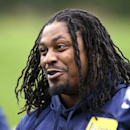 In this June 17, 2014 file photo, Seattle Seahawks' Marshawn Lynch smiles at a football minicamp practice that he watched from the sidelines in Renton, Wash. Lynch has been the workhorse Seattle has leaned on the past three seasons. He's helped bring the