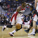 Orlando Magic point guard Jameer Nelson, right, gets caught in a pick as Washington Wizards point guard John Wall drives to the basket during the second half of an NBA basketball game on Tuesday, Feb. 25, 2014, in Washington. Wall scored a game high 27 po