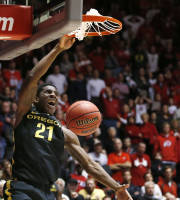 Oregon's Damyean Dotson slams in the game-winning shot during overtime against Utah in an NCAA college basketball game in Salt Lake City, Thursday, Jan. 2, 2014. Oregon won 70-68. (AP photo/George Frey)
