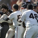 San Francisco Giants' Angel Pagan, left, celebrates with teammates after hitting an inside-the-park two-run home run off Colorado Rockies pitcher Rafael Betancourt during the tenth inning of a baseball game in San Francisco, Saturday, May 25, 2013. The Giants won 6-5. (AP Photo/Jeff Chiu)