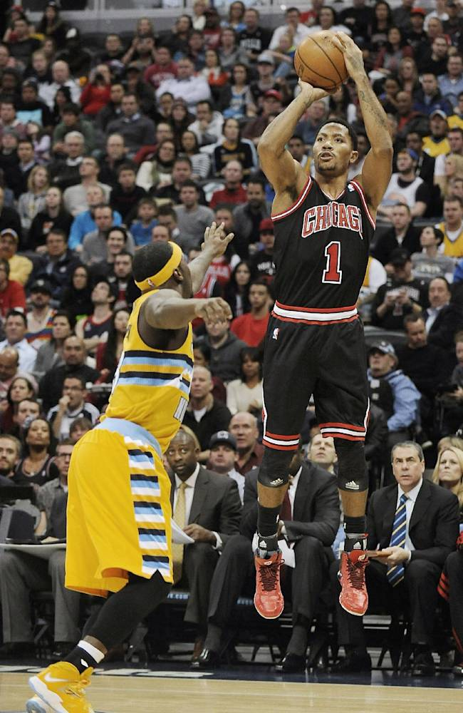 Chicago Bulls guard Derrick Rose, right, shoots over Denver Nuggets guard Ty Lawson, left, in the first quarter of an NBA basketball game on Thursday, Nov. 21, 2013, in Denver