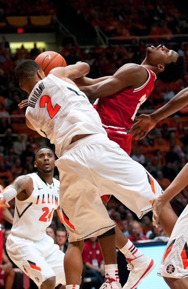Indiana Hoosiers guard Stanford Robinson (22) is fouled by Illinois Fighting Illini guard Joseph Bertrand (2) during the second half of an NCAA college basketball game in Champaign, Ill., on Tuesday, Dec.31, 2013. (AP PHOTO/Bradley Leeb)