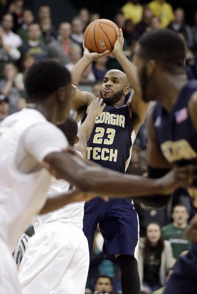 Georgia Tech's Trae Golden (23) shoots the game-winning basket against Charlotte during the second half of an NCAA college basketball game in Charlotte, N.C., Sunday, Dec. 29, 2013. Georgia Tech won 58-55
