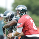 Philadelphia Eagles' Matt Barkley, right, hands the ball off to LeSean McCoy during NFL football training camp on Saturday, July 26, 2014, in Philadelphia The Associated Press
