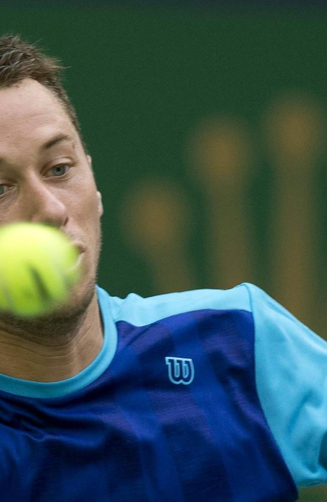 Germany's Philipp Kohlschreiber returns a shot from Argentina's Juan Martin del Potro during the Shanghai Masters tennis tournament at the Qizhong Forest Sports City Tennis Center in Shanghai, China, Wednesday, Oct. 9, 2013. Del Potro won 3-6, 6-3, 7-6