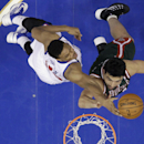 Milwaukee Bucks' Zaza Pachulia, right, of Georgia, cannot get a shot past Philadelphia 76ers' Daniel Orton during the first half of an NBA basketball game on Friday, Nov. 22, 2013, in Philadelphia The Associated Press