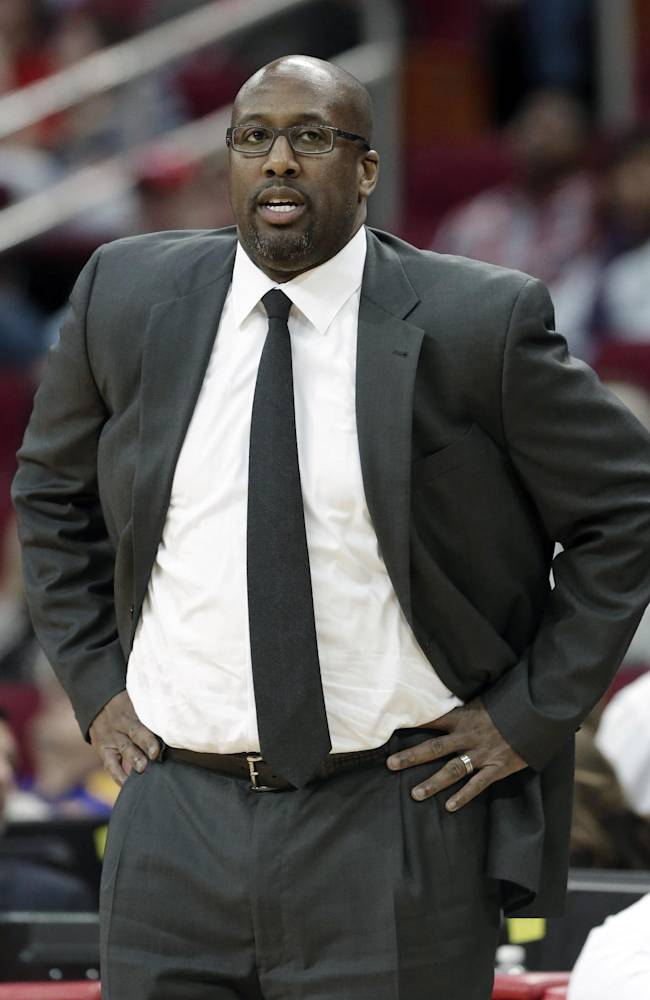 Cleveland Cavaliers coach Mike Brown watches the action against the Houston Rockets in the first half of an NBA basketball game Saturday, Feb. 1, 2014, in Houston