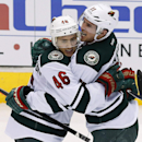 Minnesota Wild's Zach Parise (11) celebrates his goal against the Phoenix Coyotes with teammate Jared Spurgeon (46) during the third period of an NHL hockey game, Saturday, March 29, 2014, in Glendale, Ariz. The Wild defeated the Coyotes 3-1 The Associate