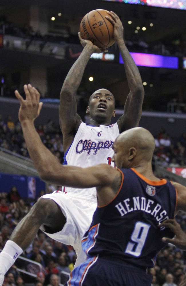 Los Angeles Clippers guard Jamal Crawford, left, shoots over Charlotte Bobcats guard Gerald Henderson (9) during the first half of an NBA basketball game Wednesday, Jan. 1, 2014, in Los Angeles. (AP Photo/Alex Gallardo)
