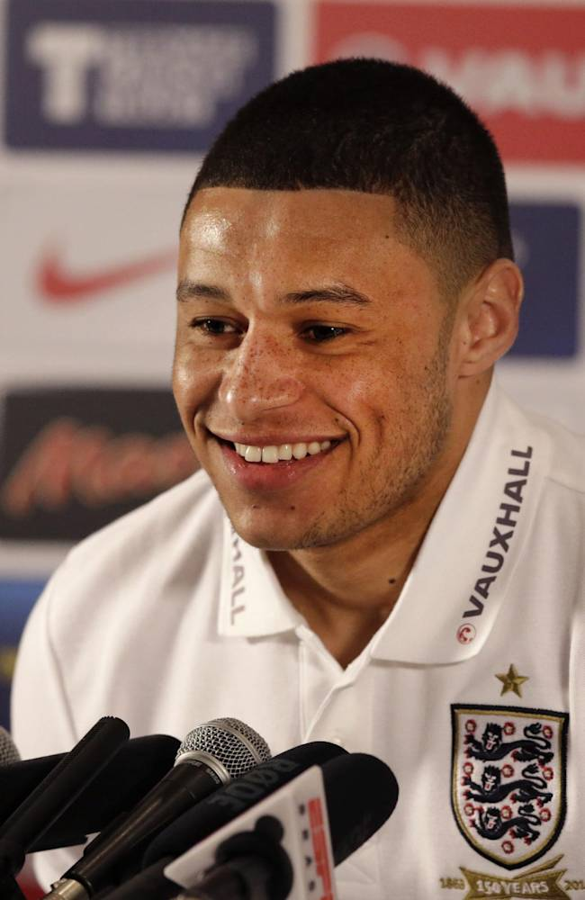 England's Alex Oxlade-Chamberlain smiles during a press conference at a hotel in Chandler's Cross, England, Monday, March 3, 2014.  England play Denmark in an international friendly soccer match at Wembley stadium in London on Wednesday