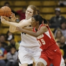 New Mexico guard Antiesha Brown, front, tips the ball away from Colorado center Rachel Hargis for a steal in the first half of an NCAA college basketball game in Boulder, Colo., on Saturday, Dec. 29, 2012. (AP Photo/David Zalubowski)