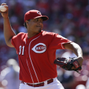 Cincinnati Reds starting pitcher Alfredo Simon throws against the Pittsburgh Pirates in the fifth inning of a baseball game, Saturday, Sept. 27, 2014, in Cincinnati The Associated Press