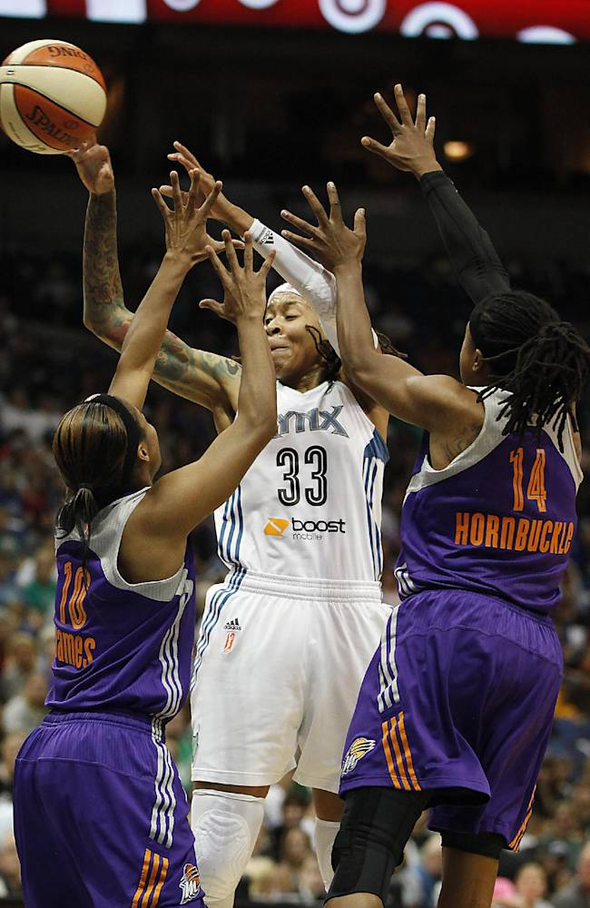 Minnesota Lynx guard Seimone Augustus (33) passes the ball past Phoenix Mercury guard Jasmine James (10) and guard Alexis Hornbuckle (14) during Game 1 of the WNBA basketball playoffs Western Conference finals on Thursday, Sept. 26, 2013, in Minneapolis
