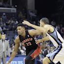 Memphis Grizzlies' Tayshaun Prince, right, defends against Toronto Raptors' Rudy Gay (22) the first half of an NBA basketball game in Memphis, Tenn., Wednesday, Nov. 13, 2013 The Associated Press