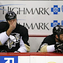 Pittsburgh Penguins' Rob Scuderi (4) and Craig Adams (27) sit on the bench in the third period of an NHL hockey game against the Los Angeles Kings in Pittsburgh, Thursday, March 27, 2014. The Kings won 3-2 The Associated Press