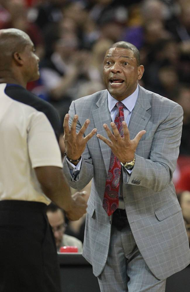 Los Angeles Clippers head coach Doc Rivers, right, questions official Derrick Collins about a foul call during the third quarter of an NBA basketball game against the Sacramento Kings in Sacramento, Calif., Friday, Nov. 1, 2013. The Clippers won 110-101