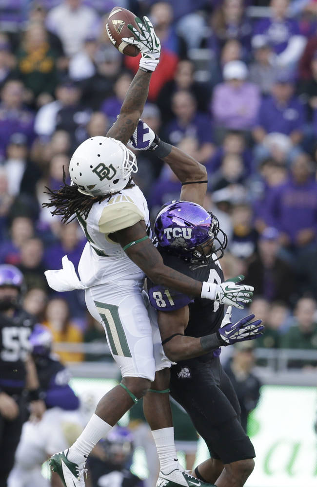 Baylor cornerback Joe Williams (22) breaks up a pass against TCU wide receiver Bailey Desormeaux (81) during the first half of an NCAA college football game Saturday, Nov. 30, 2013, in Fort Worth, Texas