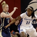 Navy's M.L. Morrison (24) defends Kentucky's DeNesha Stallworth (11) during the first half of a first-round game in the women's NCAA college basketball tournament Sunday, March 24, 2013, in New York. (AP Photo/Frank Franklin II)