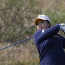 Inbee Park of South Korea watches her shot on the 18th hole during the third round of the LPGA KEB Hana Bank Championship golf tournament at Sky72 Golf Club in Incheon, South Korea, Saturday, Oct. 18, 2014. (AP Photo/Ahn Young-joon)