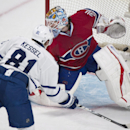 Toronto Maple Leafs' Phil Kessel scores against Montreal Canadiens' goaltender Peter Budaj during the third period of an NHL hockey game in Montreal, Saturday, March 1, 2014 The Associated Press