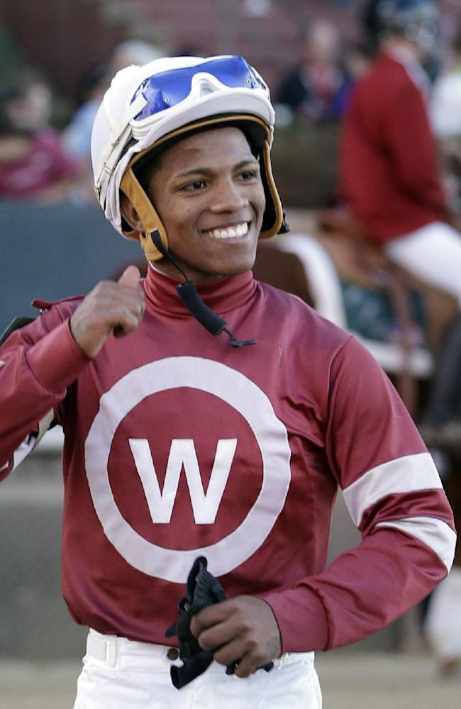 Jockey Ricardo Santana Jr., walks across the track after winning the $300,000 Southwest Stakes horse race aboard Tapiture at Oaklawn Park in Hot Springs, Ark., Monday, Feb. 17, 2014