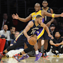 New Orleans Pelicans guard Eric Gordon (10) works his way around Los Angeles Lakers guard Jodie Meeks, back center, in the second half of an NBA basketball game, Tuesday, March 4, 2014, in Los Angeles. The Pelicans won 132 to 125 The Associated Press