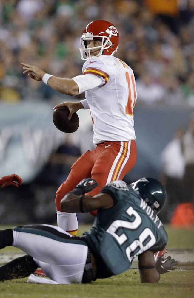 Kansas City Chiefs' Alex Smith looks to pass over Philadelphia Eagles' Earl Wolff during the first half of an NFL football game, Thursday, Sept. 19, 2013, in Philadelphia