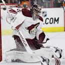 Arizona Coyotes goalie Mike Smith (41) fails to stop a shot for a goal by the Philadelphia Flyers' R. J. Umberger, not pictured, in the second period of an NHL hockey game, Tuesday, Jan. 27, 2015, in Philadelphia. (AP Photo/Tom Mihalek)