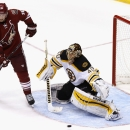 Boston Bruins' Tuukka Rask (40), of Finland, protects the net as a shot goes wide while Arizona Coyotes' Shane Doan (19) looks on during the third period of an NHL hockey game Saturday, Dec. 6, 2014, in Glendale, Ariz. The Bruins defeated the Coyotes 5-2