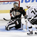 Los Angeles Kings left wing Dwight King, right, scores the winning goal post Anaheim Ducks goalie Jonas Hiller during a shootout in an NHL hockey game in Anaheim, Calif., Tuesday, Dec. 3, 2013 The Associated Press
