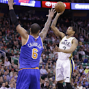 Utah Jazz's Trey Burke (3) shoots as New York Knicks' Tyson Chandler (6) defends in the first quarter during an NBA basketball game Monday, March 31, 2014, in Salt Lake City The Associated Press