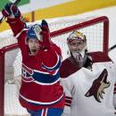 Montreal Canadiens' Brendan Gallagher celebrates a goal by Andrei Markov against Phoenix Coyotes goalie Mike Smith during the third period of an NHL hockey game Tuesday, Dec. 17, 2013, in Montreal. Montreal won 3-1. (AP Photo/The Canadian Press, Paul Chiasson)