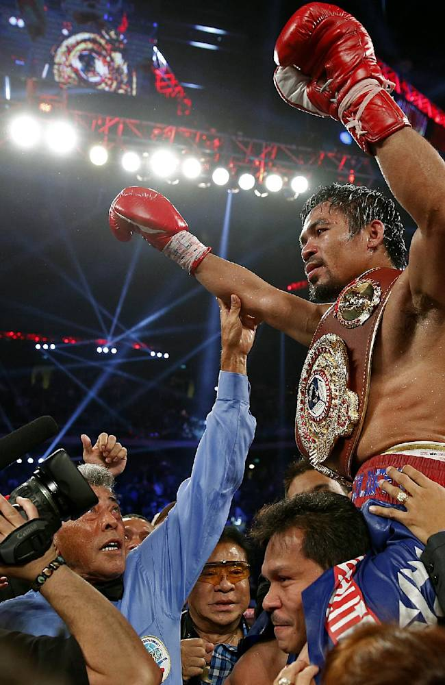 Filipino typhoon survivors cheer Pacquiao triumph