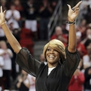 FILE - In this Feb. 17. 2013, file photo, Sheryl Swoopes acknowledges the crowd during a ceremony to honor the 1993 Texas Tech national championship team at an NCAA college basketball game between Texas Tech and Texas in Lubbock, Texas. On Monday, April 15, 2013, Loyola of Chicago formally introduced Swoopes, a four-time WNBA champion and three-time Olympic gold medalist, as their new women's basketball coach. Swoopes takes over a Ramblers program as the school moves to the Missouri Valley Conference. (AP Photo/The Avalanche-Journal, Zach Long, File)