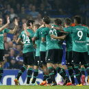 Schalke players celebrate scoring their first goal during the Champions League group G soccer match between Chelsea and Schalke 04 at Stamford Bridge stadium in London, Wednesday, Sept. 17, 2014