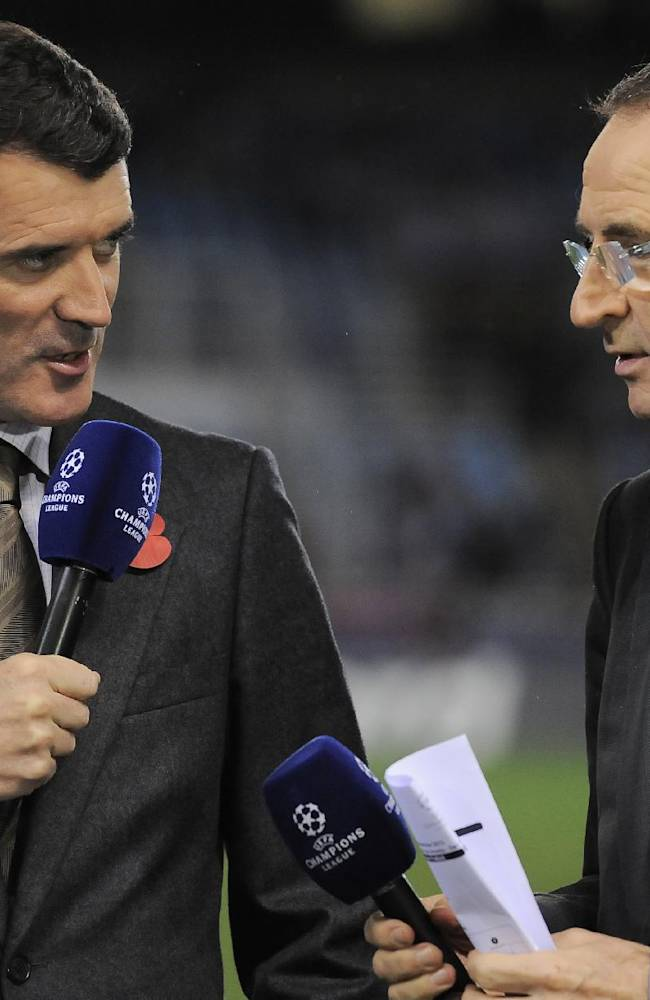 Newly appointed Ireland national soccer team coach Martin O'Neill, right, and Roy Keane, who will be his assistant, speak before Manchester United and Real Sociedad face each other in a Champions League Group A soccer match at Anoeta stadium in San Sebastian, northern Spain, Tuesday, Nov. 5, 2013