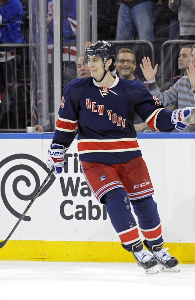 New York Rangers' Chris Kreider celebrates after scoring during the third period of an NHL hockey game against the Vancouver Canucks Saturday, Nov. 30, 2013, at Madison Square Garden in New York. It was Kreider's third goal for a hat trick leading the Rangers to a 5-2 win